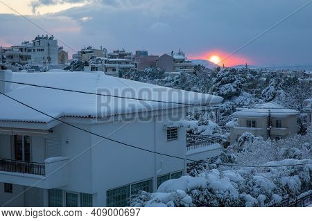 A Beautiful Winter Evening Before Sunset Panoramic View Of The Snow-covered Roofs And Streets Of Ath