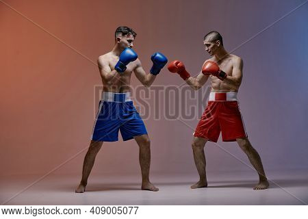 Wrestling Of Two Fighting Males Boxers In Red Light In Studio, Martial Arts, Mixed Fight Concept