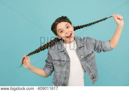 When My Hair Is Long I Go To Salon. Happy Child Hold Long Hair Blue Background. Little Girl Smile Wi