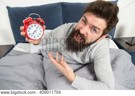 Tips For Waking Up Early. Man Bearded Hipster Sleepy Face Waking Up. Daily Schedule For Healthy Life