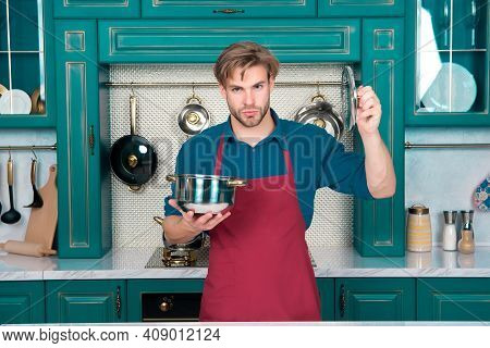Cook Man Hold Saucepan And Lid In Kitchen. Cookware, Tool, Kitchenware. Macho With Cooking Pot For S
