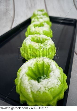 Steamed Rice Cake With Desiccated Coconut On Top. Locally Known As Apam Nasi Or Apam Beras. Selectiv