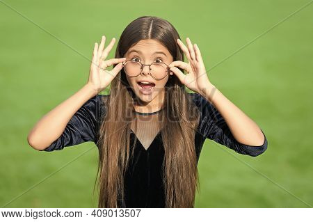 Adorable Small Child With Surprised Look And Open Mouth Hold Corrective Glasses Slipping Down Nose G