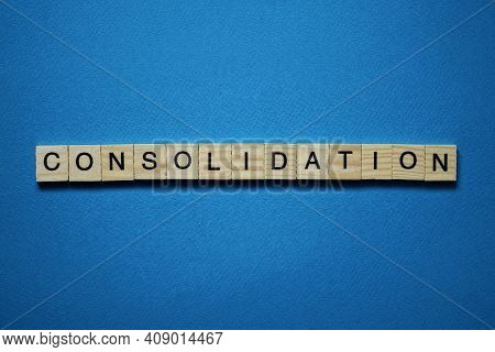 Gray Word Consolidation In Small Square Wooden Letters With Black Font On A Blue Background
