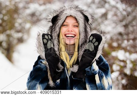 Winter Holidays. Happy Young Woman In Winter. Smiling Girl In Snow Park. Beautiful Female In Warm Co