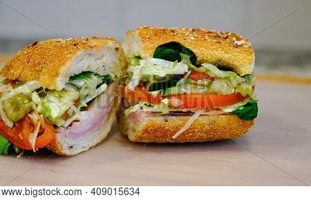 Ham And Turkey Sub Sandwich On Cutting Board