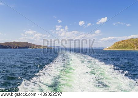 Starks Channel Between Russkiy And Popovs Islands With Ferry Trails On Sunny Day