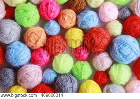 Colorful Background Of Multi-colored Yarn For Knitting, Crocheting. Lots Of Balls Of Yarn For Knitti