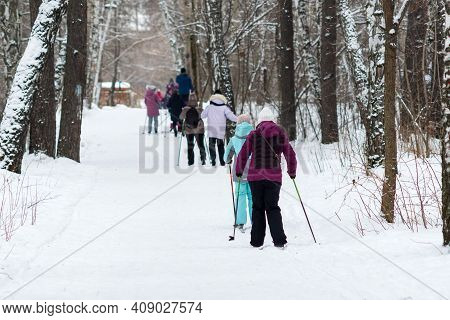 Men Skiing In The Winter In The Forest. Selective Focus.