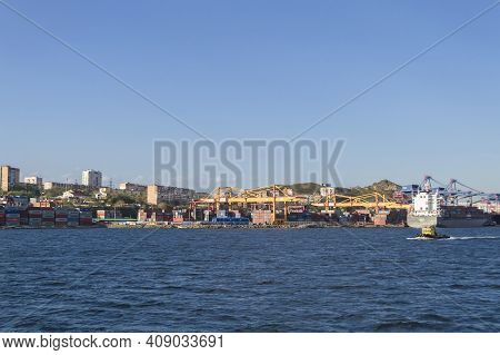 Vladivostok, Russia - October 07, 2020: View From The Sea On Large Cargoes Stacked On Freighters And