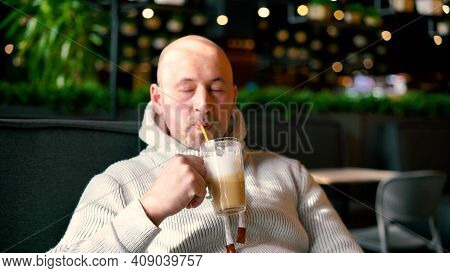Trendy Attractive Man Drinking Coffee In Cafe. Handsome Man Drinks Coffee In Cafe. Breakfast And Cof