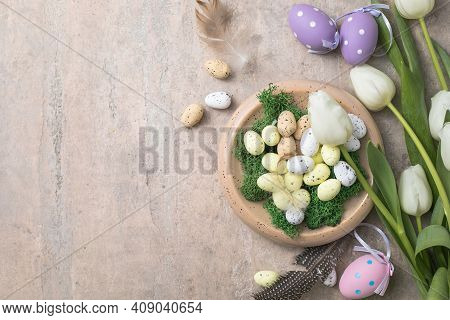 Easter Composition With Colorful Easter Eggs And Spring Flowers  Tulips On Concrete Background. East