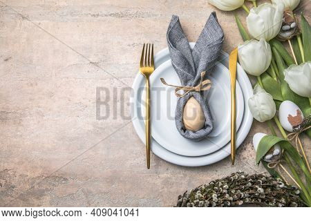 Easter Holiday Table Setting With Bunny  From Egg On White Plate And Tulips Flowers.  Gray Concrete