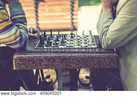 Two Old Men Playing Chess. Active Retired People, Old Friends And Free Time. Active Retired People O