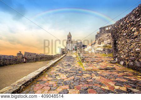 Rainbow On Portovenere (porto Venere) In Liguria, Italy: Scenic View Of The Church Of St. Peter (chi
