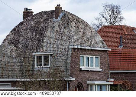 Curved Roof Of House From The Fities Covered With Slate Stones In The Netherlands