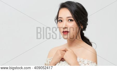 Asian  Beauty Young Happy Woman With Healthy Skin And Beautiful Hairstyle Female Girl Model Portrait