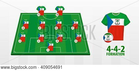 Equatorial Guinea National Football Team Formation On Football Field. Half Green Field With Soccer J