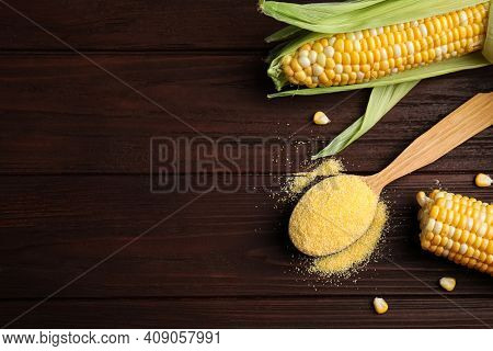 Cornmeal In Spoon And Fresh Cobs On Wooden Table, Flat Lay. Space For Text