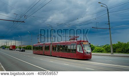 Red Modern Tram On The Street In Kazan, Russia. Kazans Tram Networks Consists Of 5 Lines.