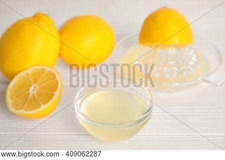 Freshly Squeezed Lemon Juice On White Table