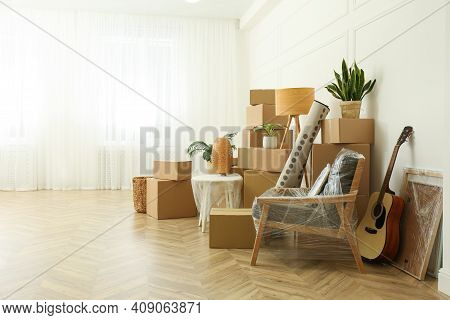 Cardboard Boxes And Household Stuff Indoors, Space For Text. Moving Day