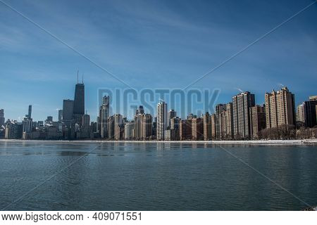 Chicago City Urban Skyscraper By Day At Downtown Lakefront  With Lake Michigan And Water Reflection