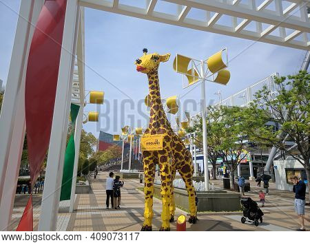 Osaka, Japan - April 4, 2018: Tall Lego Giraffe Stands On A Street In Osaka, Japan. Here You Can Get