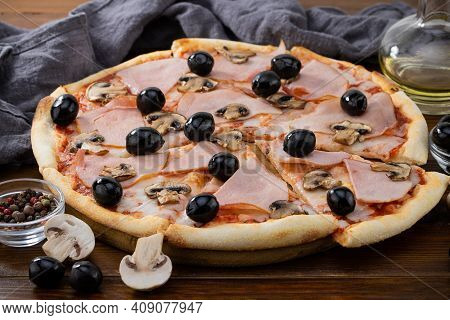 Pizza And Pizza Ingredients. Olives, Mushrooms And Pizza On A Dark Background