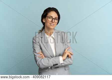 Confident Businesswoman, Smiling, Looking At Camera Standing With Crossed Arms Isolated On Blue Back