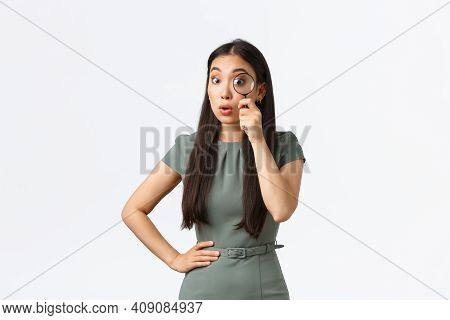 Small Business Owners, Women Entrepreneurs Concept. Surprised Funny Asian Woman Searching For Someth