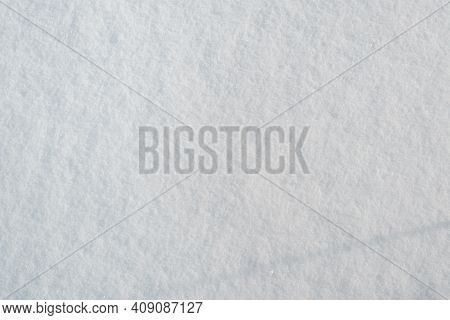 Snow Surface Texture, Sunny Winter Day Outside. Snow Background, Soft Focus. Top View, Copy Space