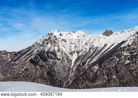 The Mountain Range Of The Monte Carega In Winter With Snow, Called The Small Dolomites View From The