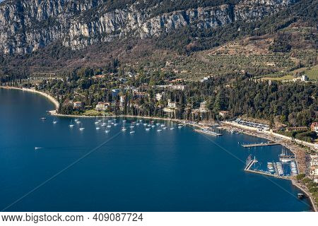 Aerial View Of The Small Garda Town, Tourist Resort On The Coast Of Lake Garda, View From The Rocca