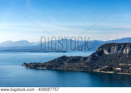Aerial View Of Punta San Vigilio. Promontory Of Lake Garda Near The Small Town Of Garda View From Th
