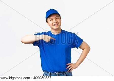 Proud Confident Smiling Asian Courier In Blue Uniform Pointing At Himself And Looking Pleased, Assur