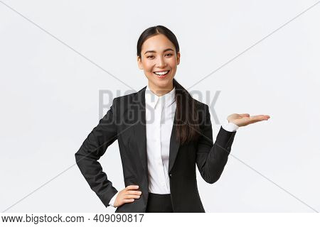 Professional Smiling Businesswoman Introduce Her Project During Meeting. Saleswoman In Black Suit Ho