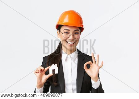 Confident Professional Female Asian Architect In Helmet And Business Suit Ensure Quality Constructio