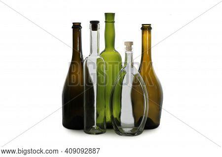 White Wine Bottle And White Oval Vodka Bottle Near Green Wine Bottle And Brown Wine Bottles Isolated