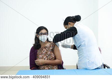 February 20, 2021, Kishanganj, Bihar, India. Female Doctor Receives Covid 19 Vaccination Second Inje