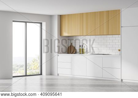 White Wooden Kitchen Set And Deck With Appliances, Side View, Window With Sunlight. Minimalist Luxur