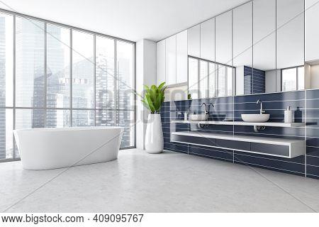 White And Blue Bathroom With Two Sinks, White Bathtub Near Window, Side View. Blue Stylish Bathroom