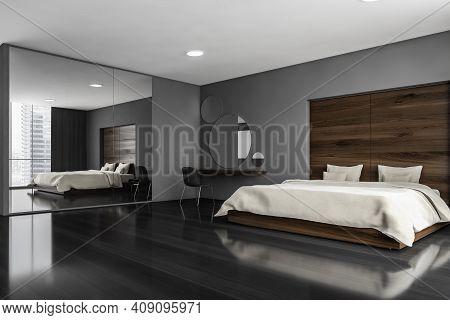 Dark Sleeping Room, Bed And Chair With Desk On Black Floor, Side View. Minimalist Design Of Bedroom