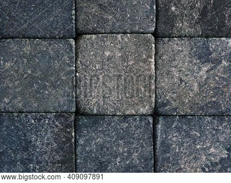 Dark Stone Background Close-up. Gray With A Blue Backdrop Or Wallpaper. Rough Matte Surface With Spl