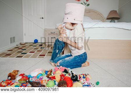 Mother Parent Playing With Baby Toddler In Bedroom. Mom And Kid Boy Girl With Toy Bin On Heads. Fami