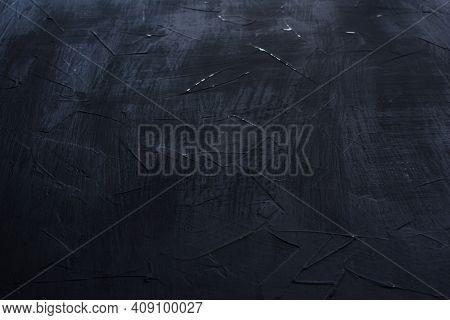 Dark Grunge Textured Wall Closeup. Black Cement Texture.