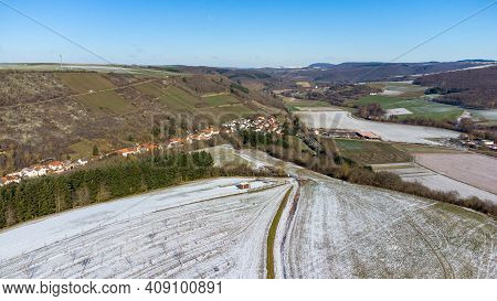 Aerial View Of The Landscape In The Palatinate And The Village Raumbach In Winter With Snow