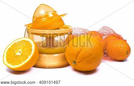 Electric Press Juicer With Cut Orange Isolated On White Background. Manual Juice Extractor. Juicing