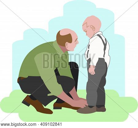 Father Tying Shoelaces To His Son. A Man In A Shirt And Trousers Squatting Tying The Laces Of A Todd
