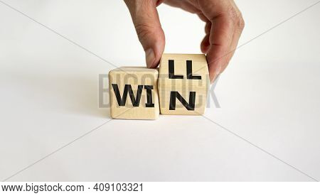 We Will Win Symbol. Businessman Turns Cubes And Changes The Word Will To Win. Beautiful White Backgr